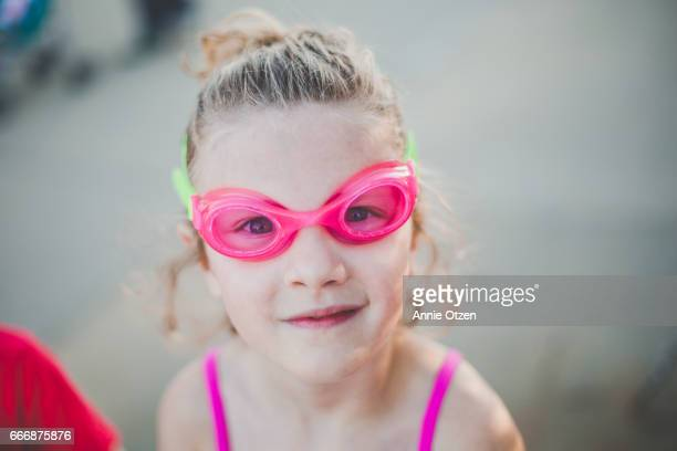 Girl with pink swim goggles