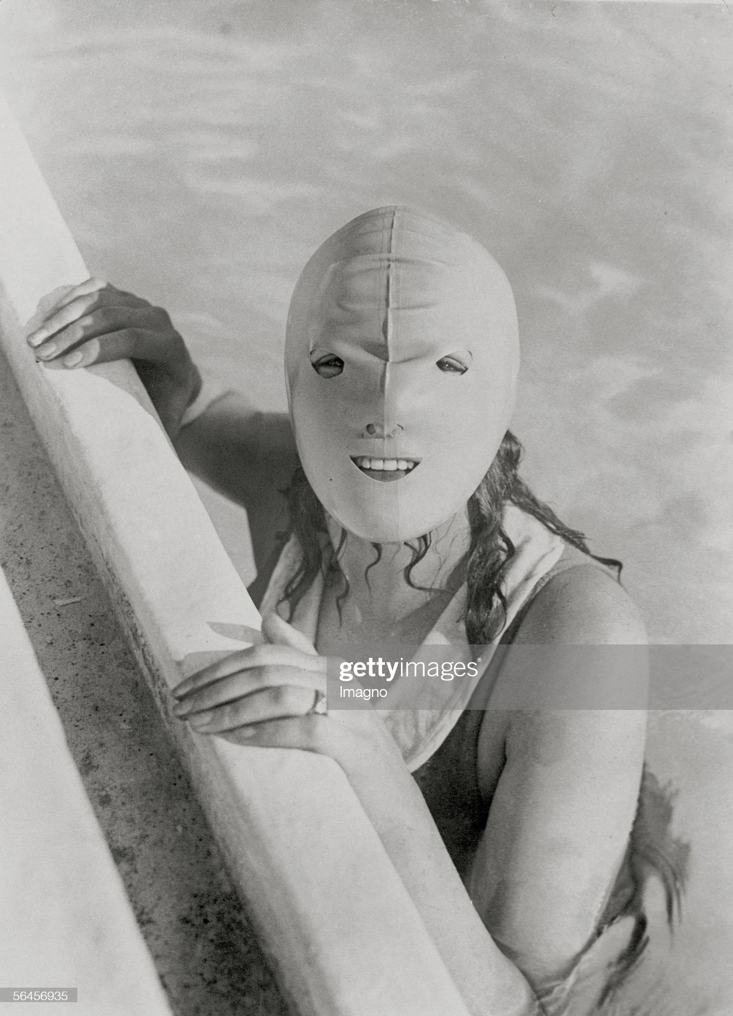 Girl with plastic mask : News Photo