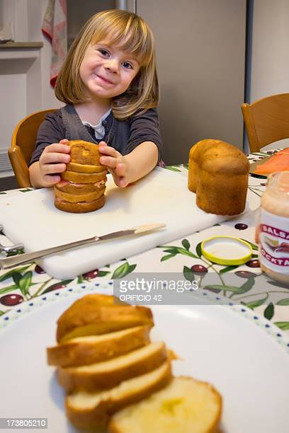 Girl with plate of sliced cake