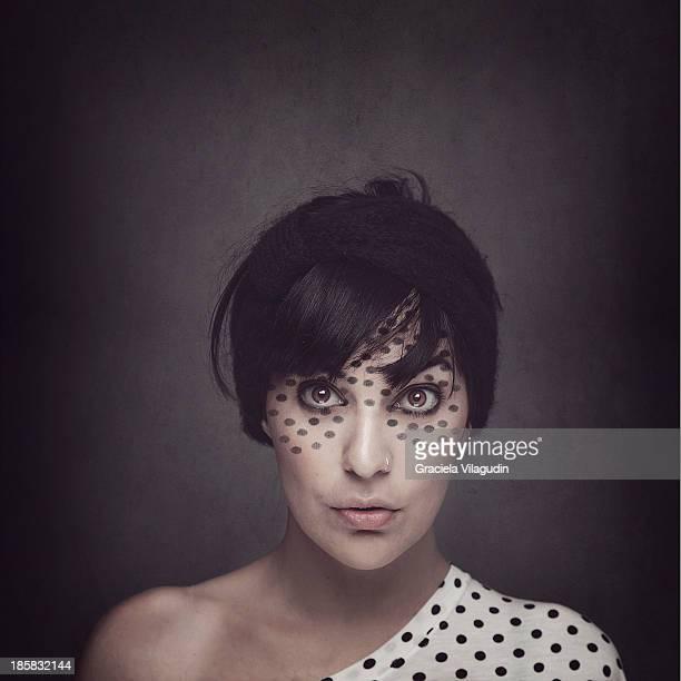 Girl with polka dot T-shirt and polka dot makeup