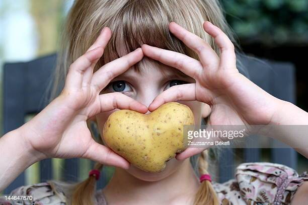 Girl with potato heart