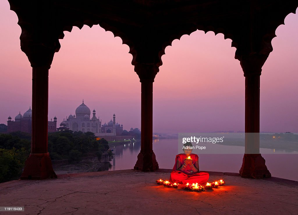 Girl with prayer lamp with Taj Mahal in background : Stock Photo