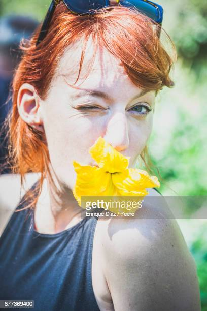 Girl with Pumpkin Flower in her Mouth