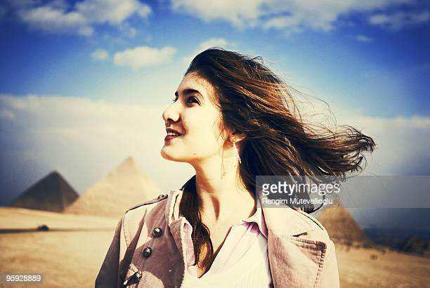 girl with pyramids - north africa stock photos and pictures