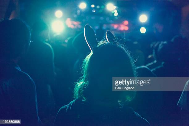 Girl with rabbit ears enjoys a music festival in Tokyo.