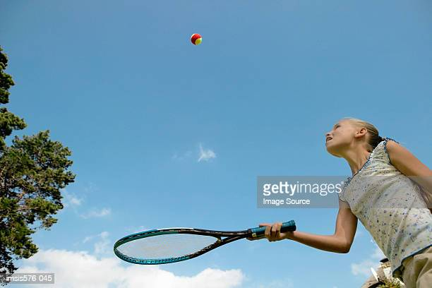 Girl with racquet and ball