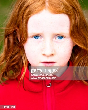 girl with red hair and blue eyes wearing red stock photo. Black Bedroom Furniture Sets. Home Design Ideas