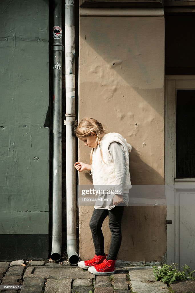 Girl with red shoes : Stock Photo