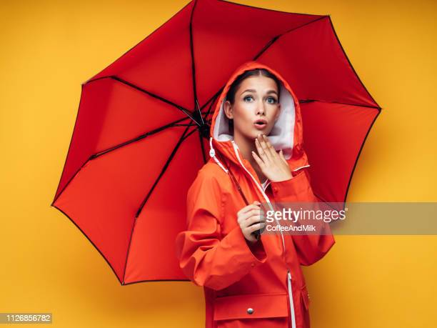 girl with red umbrella - hood clothing stock photos and pictures