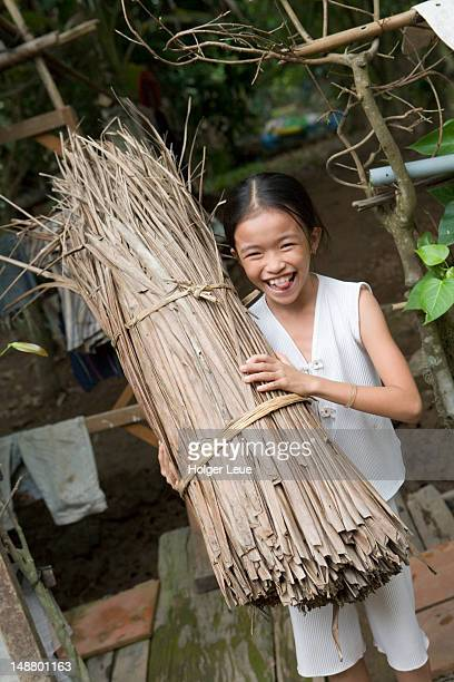 Girl with reeds at Tan Thach Island on Mekong River.