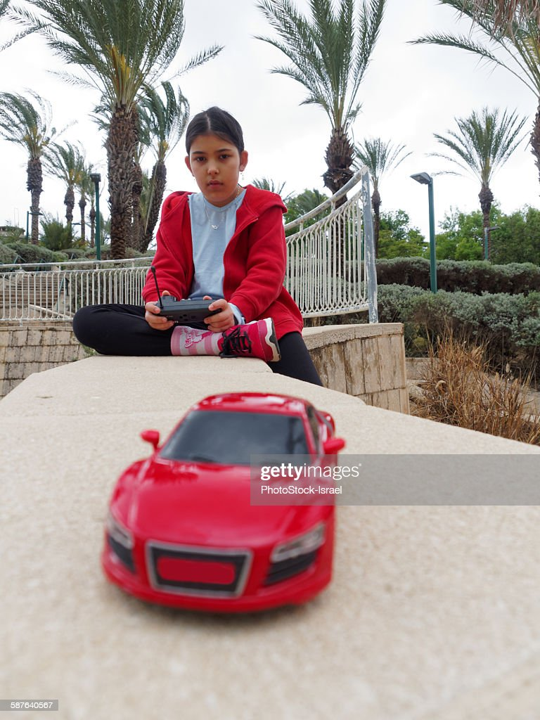 Girl with remote control car : Stock Photo
