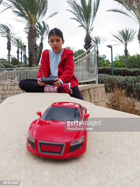 girl with remote control car - remote controlled stock photos and pictures