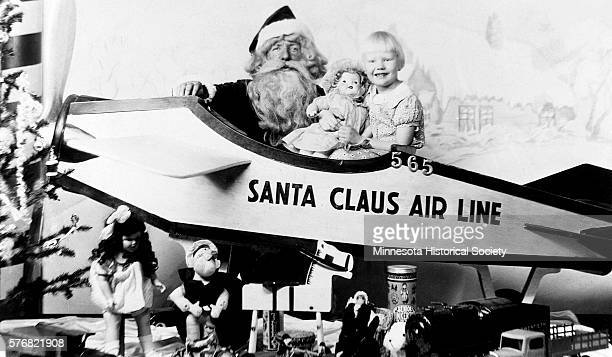Girl with Santa Claus in Toy Airplane