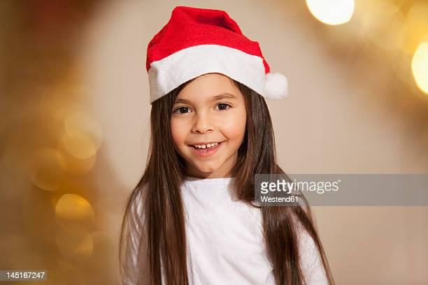 Girl with santa hat, smiling, portrait