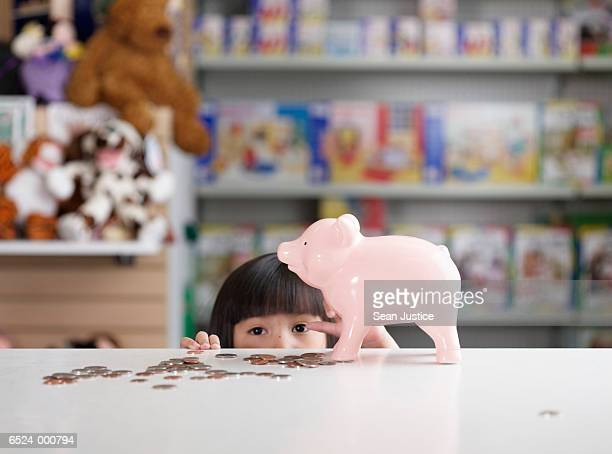 Girl with Savings in Toy Store