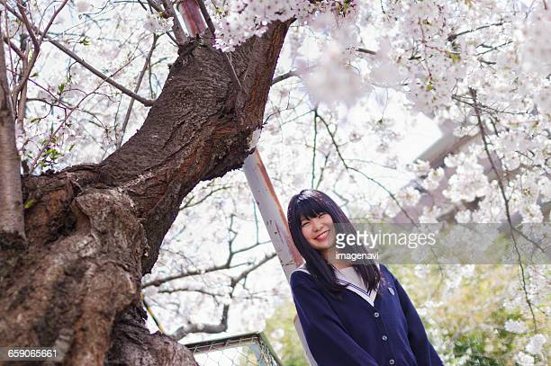 Girl with school uniform and cherry blossoms
