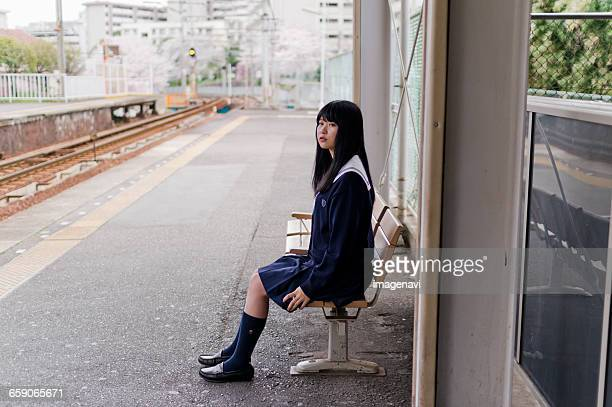 Girl with school uniform in the station