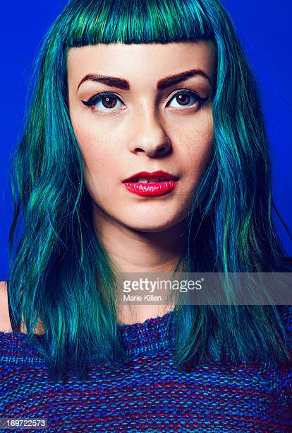 Girl with short bangs and blue and green hair