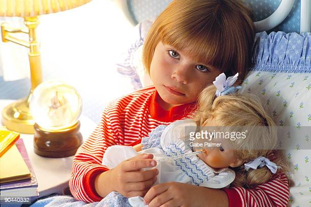 Girl with sick doll