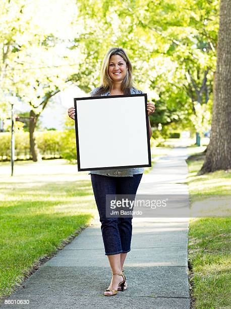 girl with sign in suburbs - person holding blank sign stock pictures, royalty-free photos & images