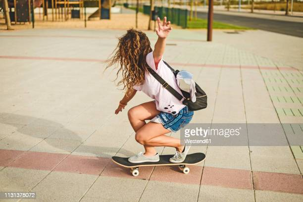 girl with skateboard - skating stock pictures, royalty-free photos & images