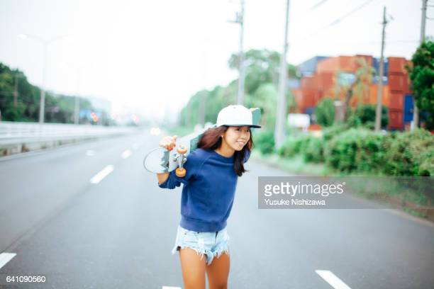 a girl with skateboard - yusuke nishizawa stock pictures, royalty-free photos & images