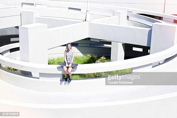 girl with skateboard - yusuke nishizawa stock-fotos und bilder