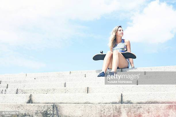 girl with skateboard - blue shorts stock pictures, royalty-free photos & images