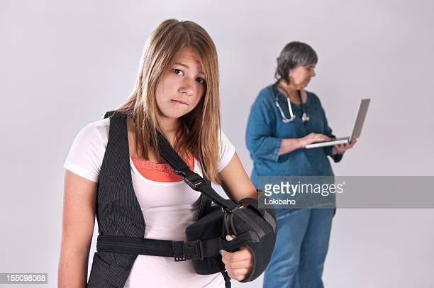 girl with sling and  her doctor - arm sling stock pictures, royalty-free photos & images