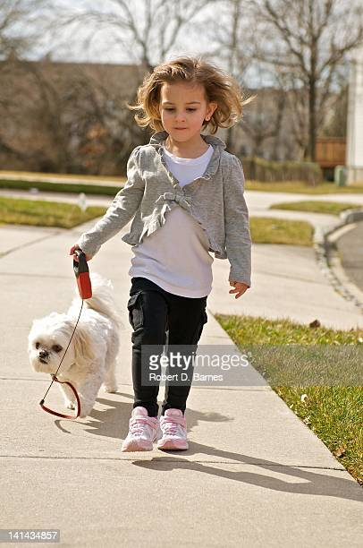 Girl with small dog on leash