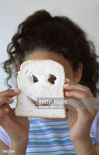 Girl with smiley face bread