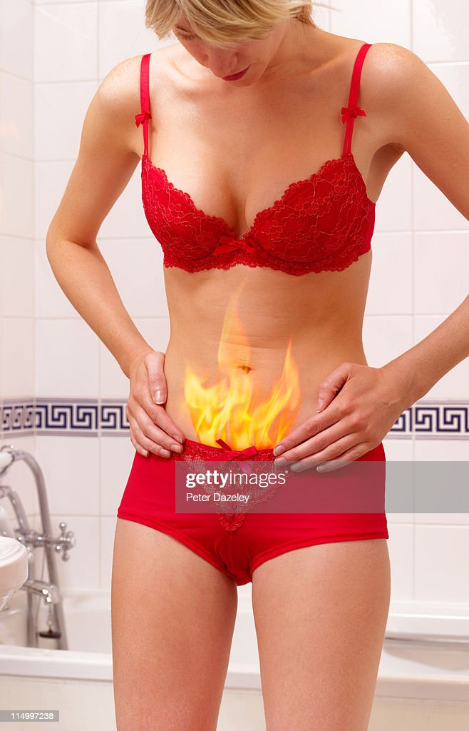 Girl with stomach pain : Stock Photo