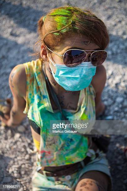 CONTENT] Girl with surgical face mask and sunglasses at holi festival in Munic Germany