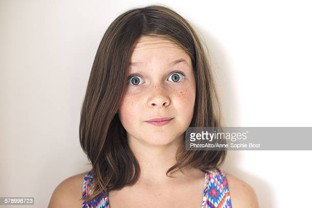 Girl with surprised expression on face, portrait