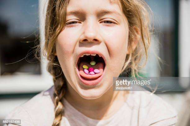 Girl with sweets in her mouth