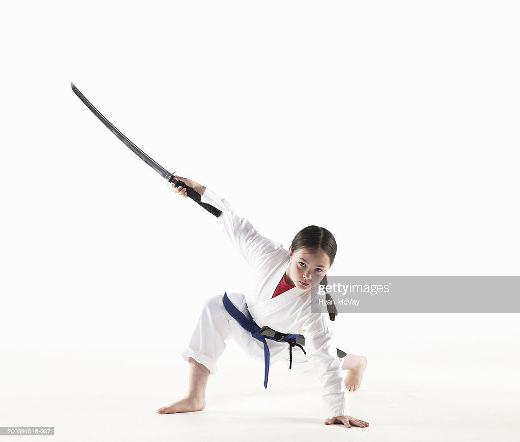 Girl With Sword Holding Kempo Karate Pose Stock Photo - Getty Images