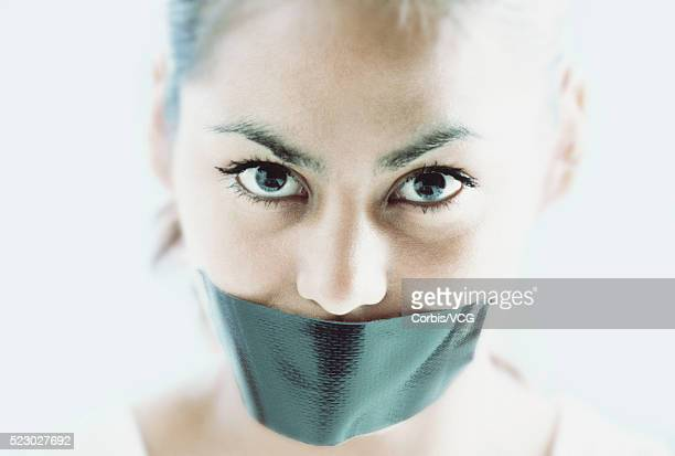 girl with tape over mouth - gagged woman stock pictures, royalty-free photos & images