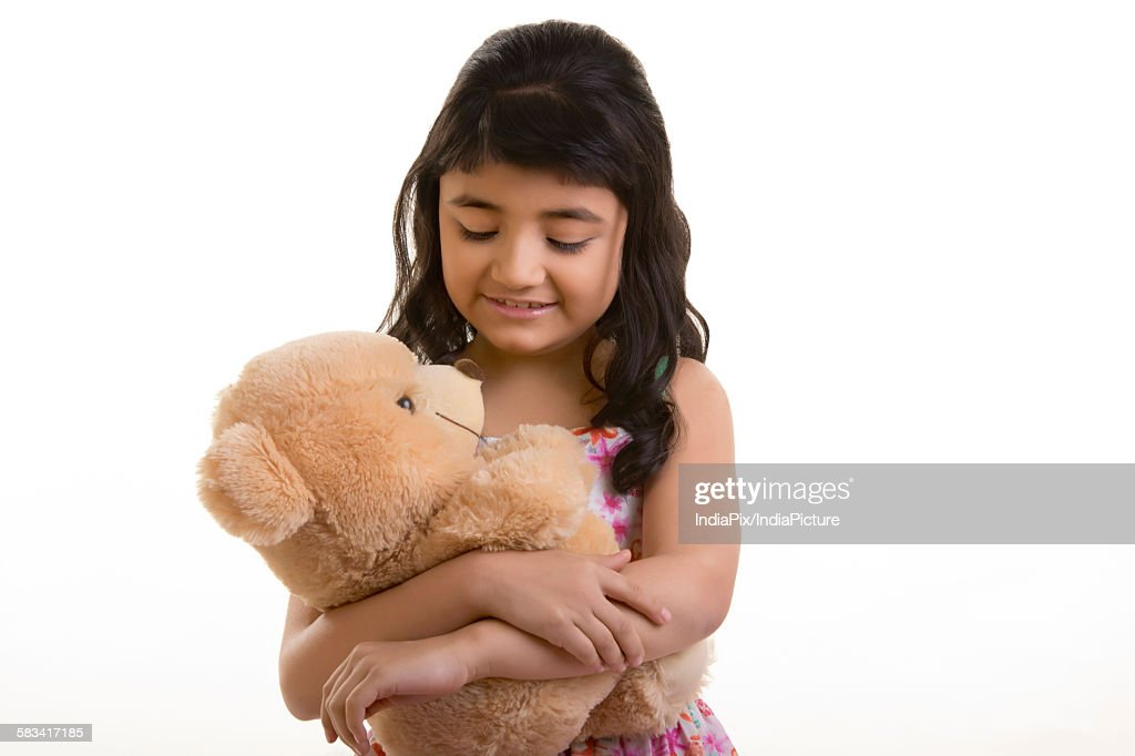 Girl with teddy bear : Stock Photo