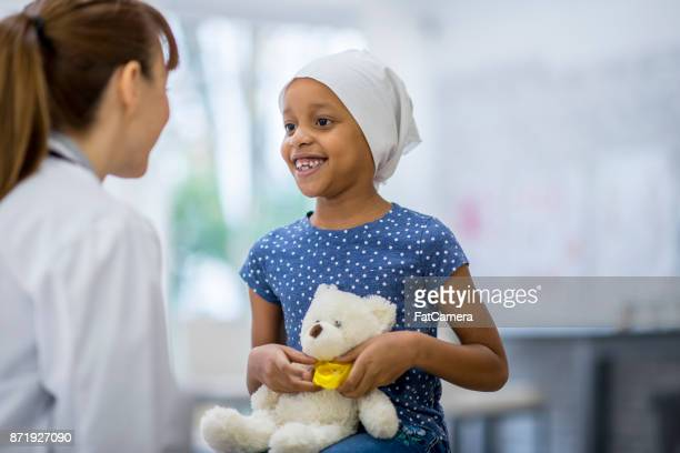 girl with teddy bear - bald girl stock photos and pictures
