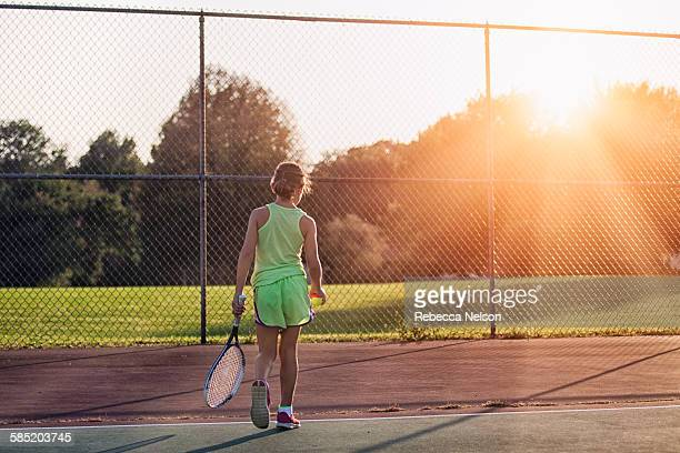 girl with tennis racket and ball