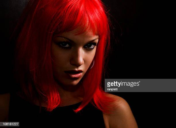 girl with the red hair - domination stock pictures, royalty-free photos & images