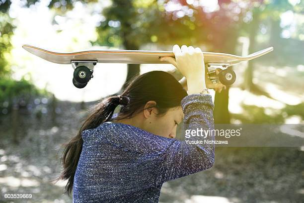 girl with the skateboard - yusuke nishizawa stock pictures, royalty-free photos & images