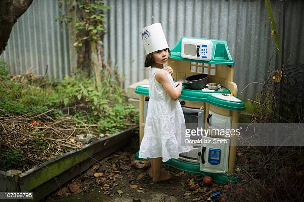 Girl with toy kitchen