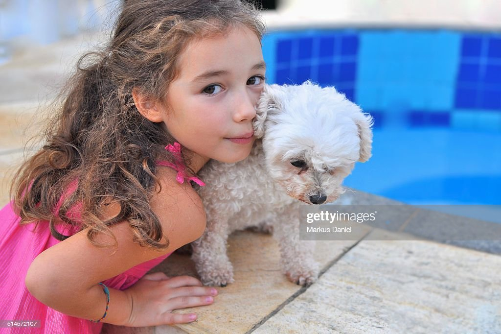 Girl with toy poodle : Stock Photo