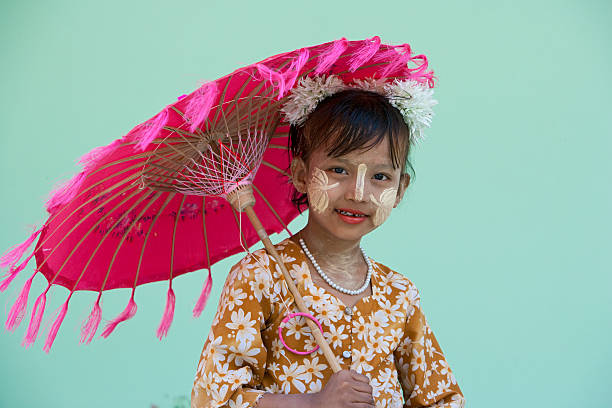 Girl with traditional decoration on hter face