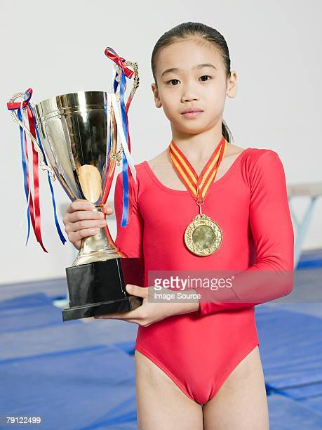 girl with trophy and medal - leotard stock photos and pictures