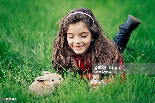 Girl with two bunnies