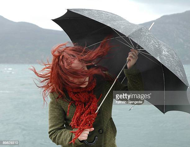 girl with umbrella and blowing hair - umbrella stock pictures, royalty-free photos & images