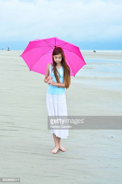 Girl with umbrella on the beach
