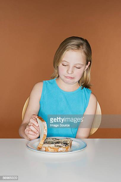Girl with unappetising sandwich